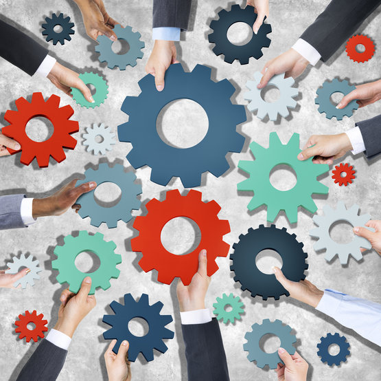 Aerial View of Business People Holding Gear Symbols